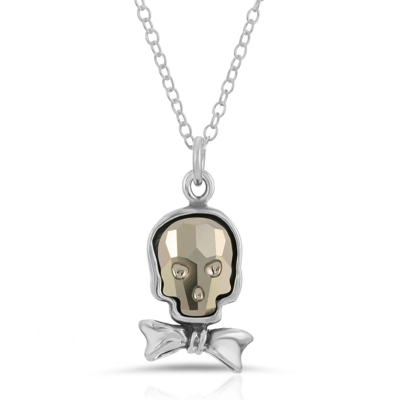 The W brothers Swarovski Skull Necklace in metallic gold with a gorgeous silver bowtie crafted from premium Grade A Sterling Silver. Perfect jewelry accessory necklace for fashionable statement women. Available at www.thewbros.com