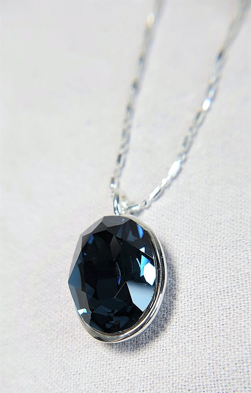 The W Brothers Premium Grade A 925 Sterling Silver Blue Montana Swarovski Pendant. Our pendant features a brilliant Oval cut synthetic crystal shimmering with Montana likeliness set on the highest quality silver, perfect for a fashionable statement for men and women's jewelry accessory. Available at www.thewbros.com