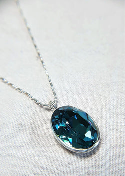 The W Brothers Premium Grade A 925 Sterling Silver Blue Zircon Swarovski Pendant. Our pendant features a brilliant Oval cut synthetic crystal shimmering with Zircon likeliness set on the highest quality silver, perfect for a fashionable statement for men and women's jewelry accessory. Available at www.thewbros.com
