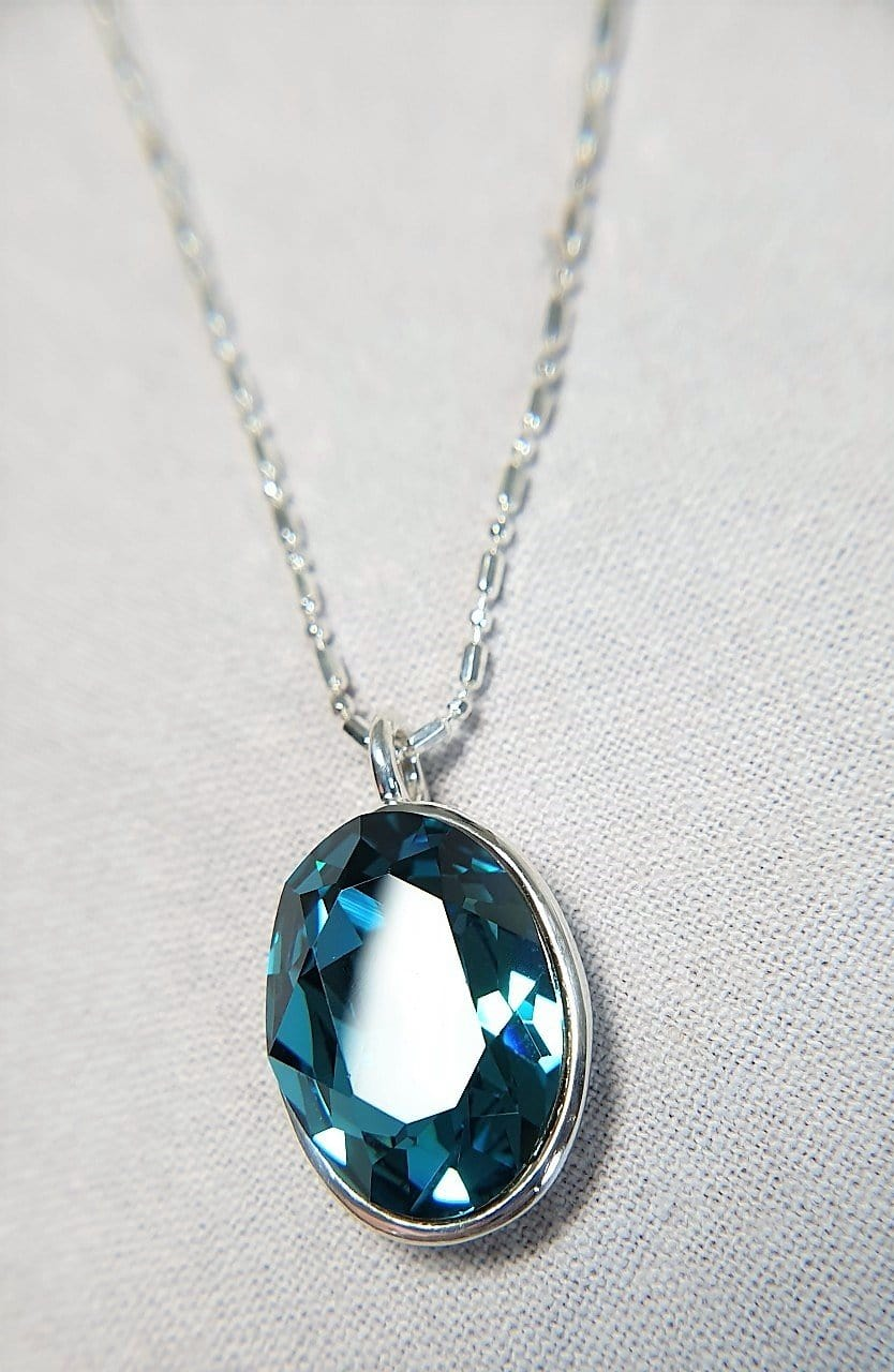 The W Brothers Blue Zircon Swarovski Sterling Silver Pendant Necklace for Female, set with a Swarovski Crystal