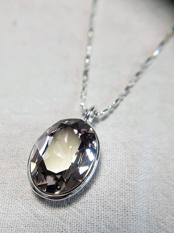 The W Brothers Dark Lavender Swarovski Sterling Silver Pendant Necklace for Female, set with a Swarovski Crystal
