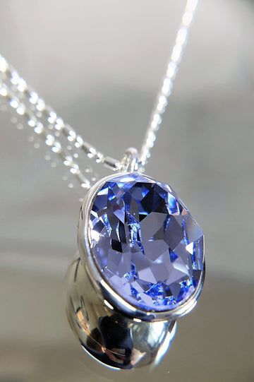 The W Brothers Dark Sapphire Swarovski Sterling Silver Pendant Necklace for Female, set with a Swarovski Crystal