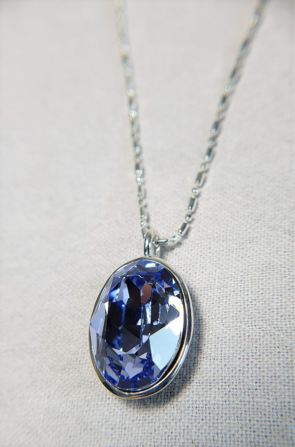 The W Brothers Premium Grade A 925 Sterling Silver Dark Sapphire Swarovski Pendant. Our pendant features a brilliant Oval cut synthetic crystal shimmering with sapphire likeliness set on the highest quality silver, perfect for a fashionable statement for men and women's jewelry accessory. Available at www.thewbros.com