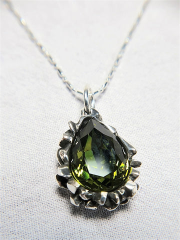 The W Brothers Pear Cut Green Peridot Swarovski Pendant Necklace crafted by 925 Sterling Silver, perfect for female and women.