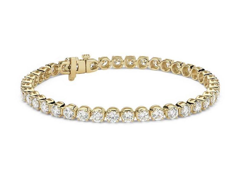 The W Brothers SI Diamond Tennis Bracelet hand-crafted with Solid 18K White Gold, Yellow Gold, and Rose Gold of the highest 18K quality. Gia Certified SI diamonds prong set on White Gold. Shop your solid gold jewelry only at thewbros.com