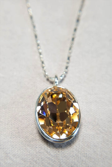 The W Brothers Smoked Topaz Pendant Necklace in 925 Sterling Silver, set with a Yellow Topaz Swarovski Crystal for female.