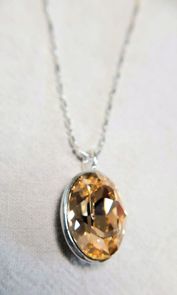 The W Brothers Premium Grade A 925 Sterling Silver Smoked Topaz Swarovski Pendant. Our pendant features a brilliant Oval cut synthetic crystal shimmering with Topaz likeliness set on the highest quality silver, perfect for a fashionable statement for men and women's jewelry accessory. Available at www.thewbros.com