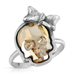 The W brothers Swarovski Skull Ring in Clear Gold with a gorgeous silver ribbon crafted from premium Grade A Sterling Silver. Perfect jewelry accessory ring for fashionable statement women. Available at www.thewbros.com