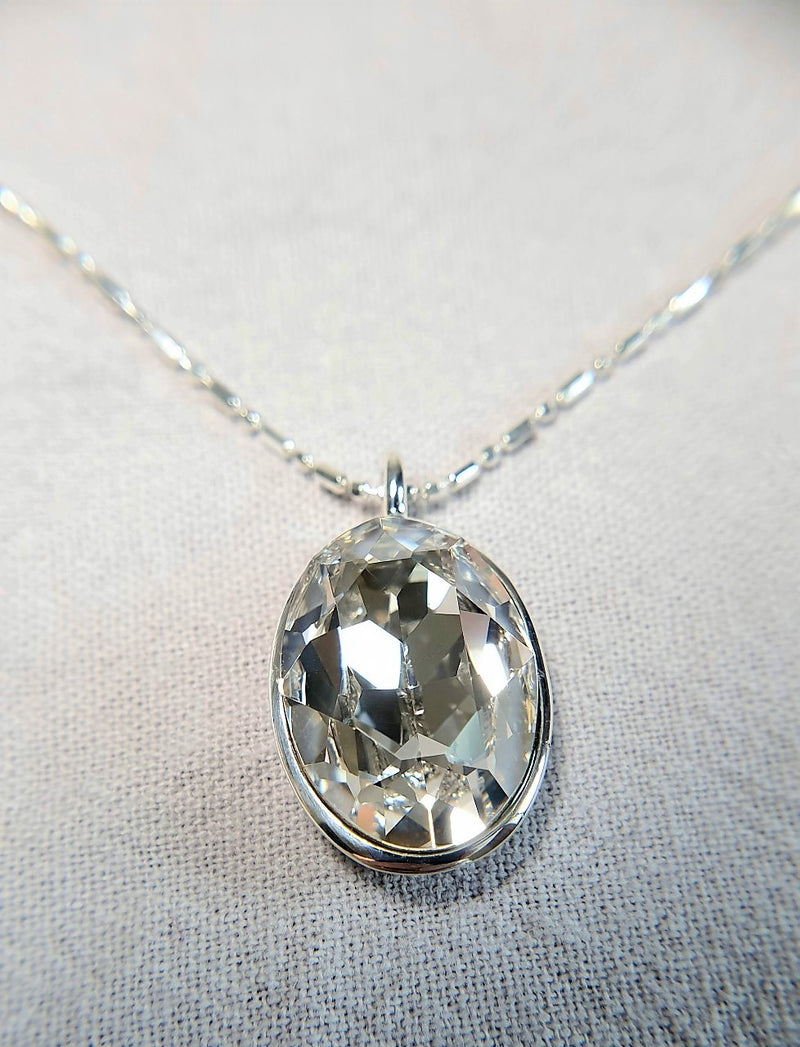 The W Brothers Premium Grade A 925 Sterling Silver White Quartz Swarovski Pendant. Our pendant features a brilliant Oval cut synthetic crystal shimmering with Quartz likeliness set on the highest quality silver, perfect for a fashionable statement for men and women's jewelry accessory. Available at www.thewbros.com