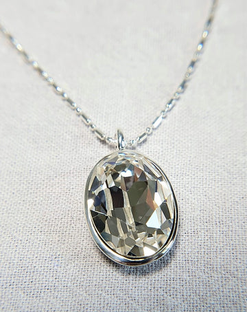 The W Brothers White Quartz Swarovski Sterling Silver Pendant Necklace for Female, set with a Swarovski Crystal