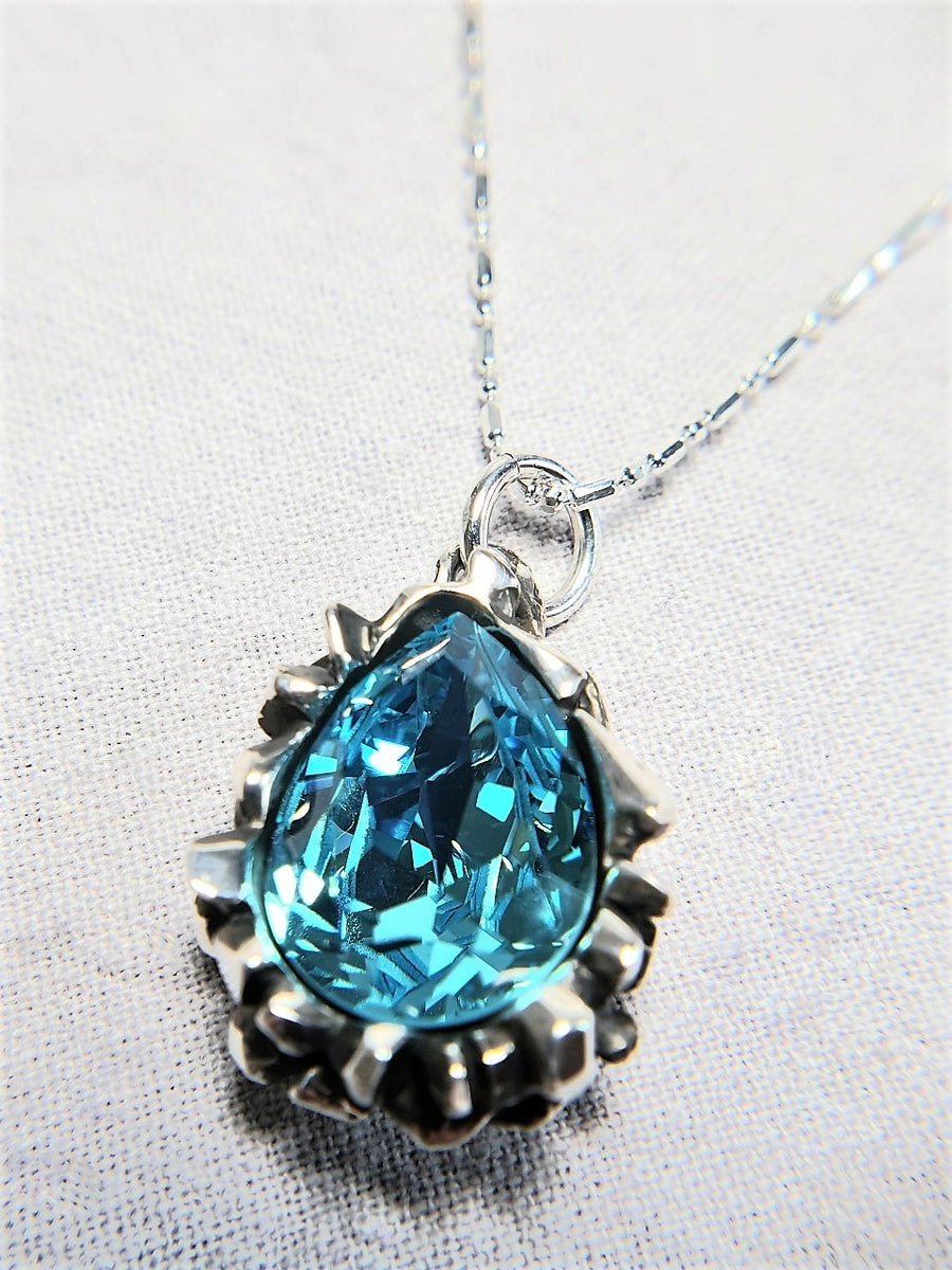 The W Brothers Pear Cut Blue Tourmaline Swarovski 925 Sterling Silver Pendant Necklace, perfect for Female and women.