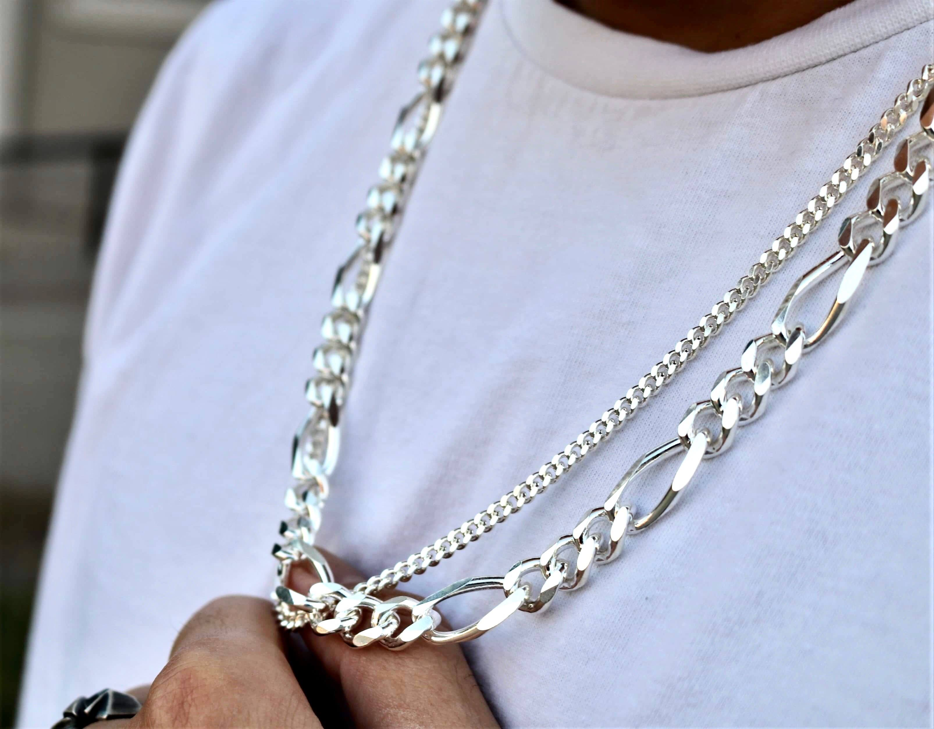 The W Brothers Sterling Silver 11 mm Figaro Chain in premium 925 Sterling silver with no recycled materials & no toxic metals. Our figaro chain is perfect for layering other chains and cuban chain necklaces, perfect for male fashion and accessories.
