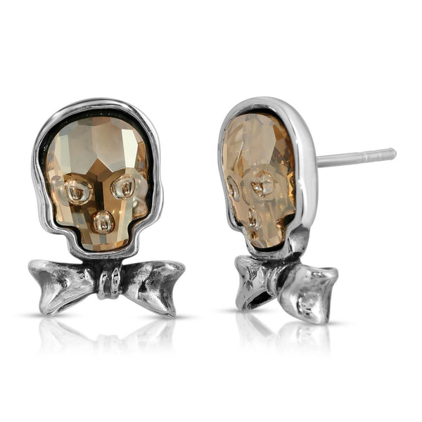 The W brothers Swarovski Skull Stud Earrings in clear gold with a gorgeous silver bow crafted from premium Grade A Sterling Silver. Perfect jewelry accessory stud earrings for fashionable statement women. Available at www.thewbros.com