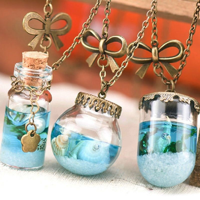 Vintage Mermaid Tears, Shells, and Star Vial - Enclosed in a Blue Sea Ocean Glass Wish Bottle