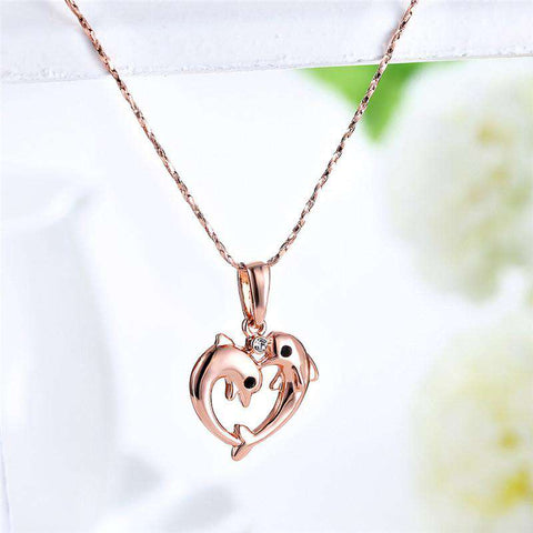 Image of Rose Gold Two Dolphin Heart Necklace - Green Earth Animals