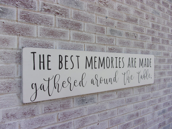The best memories are made gathered around the table sign