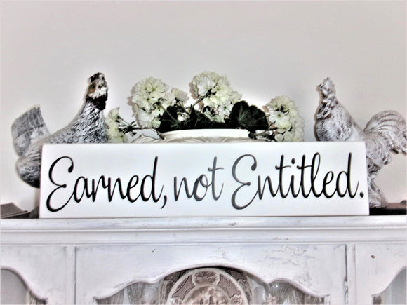 Earned not entitled sign