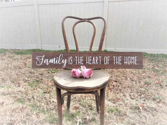 Family is the heart of the home sign