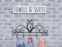 Towels and Suit sign