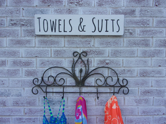 Swimming pool towels and suits sign