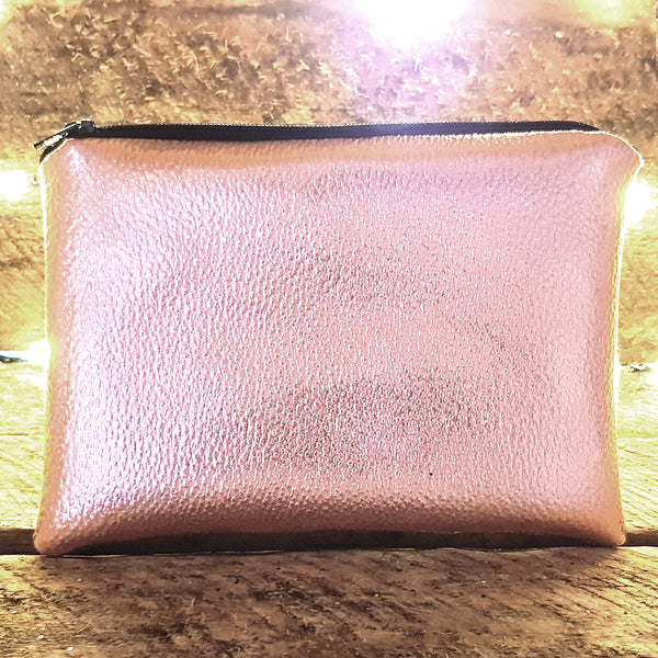 Rose gold faux leather clutch bag