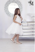 Girls occasion wear dress cream/ivory with flower decoration