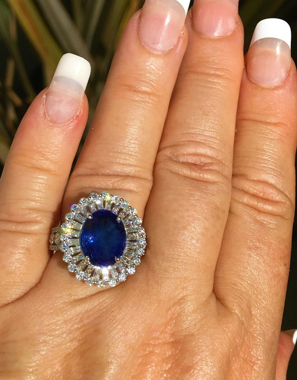18K GOLD 8.24 CT. AAA+  VIVID BLUE TANZANITE &