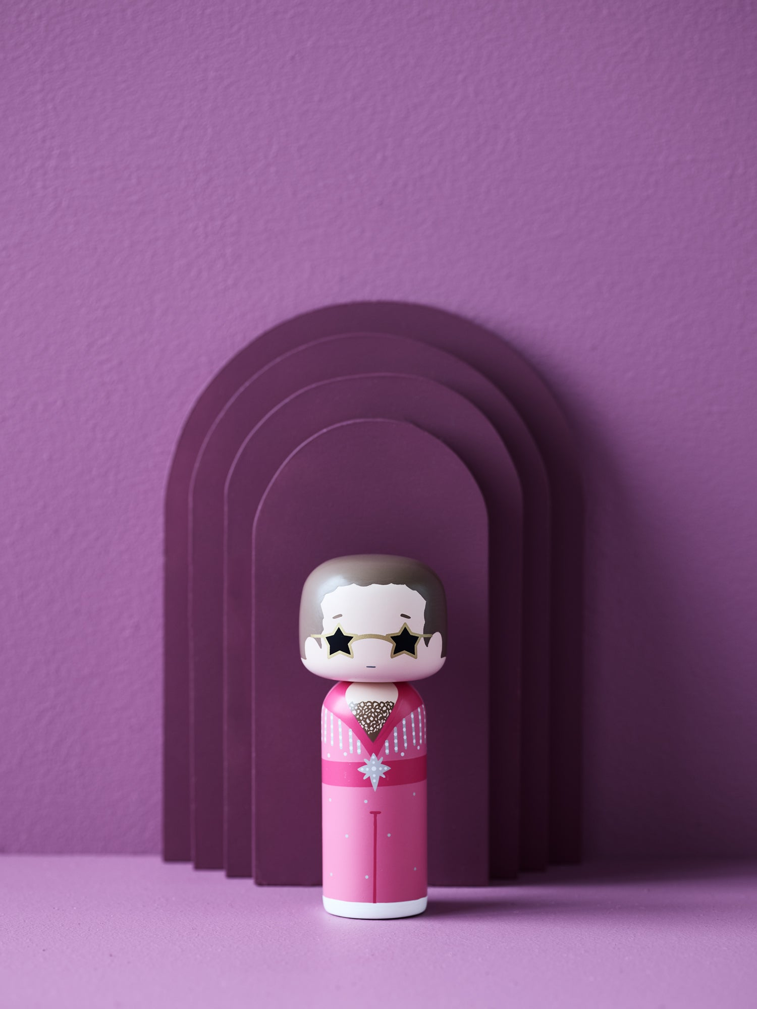 Sketch.inc for Lucie Kaas Elton Pink wooden kokeshi doll with purple background | CIRCA75