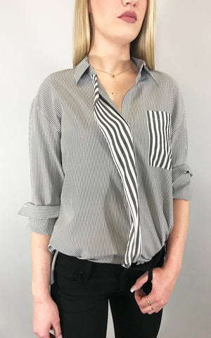 A crisp, striped blouse is a must-have for any season