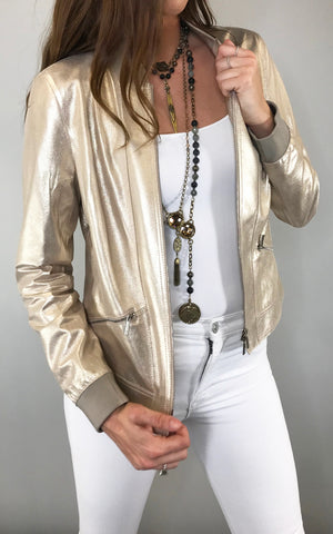 A gold leather bomber is your new go-to jacket for warmer weather