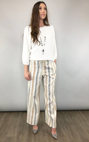 Soft stripes in loose linen are chic and feminine