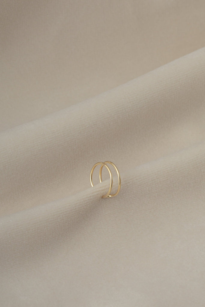 Celia Cuff Gold on textile