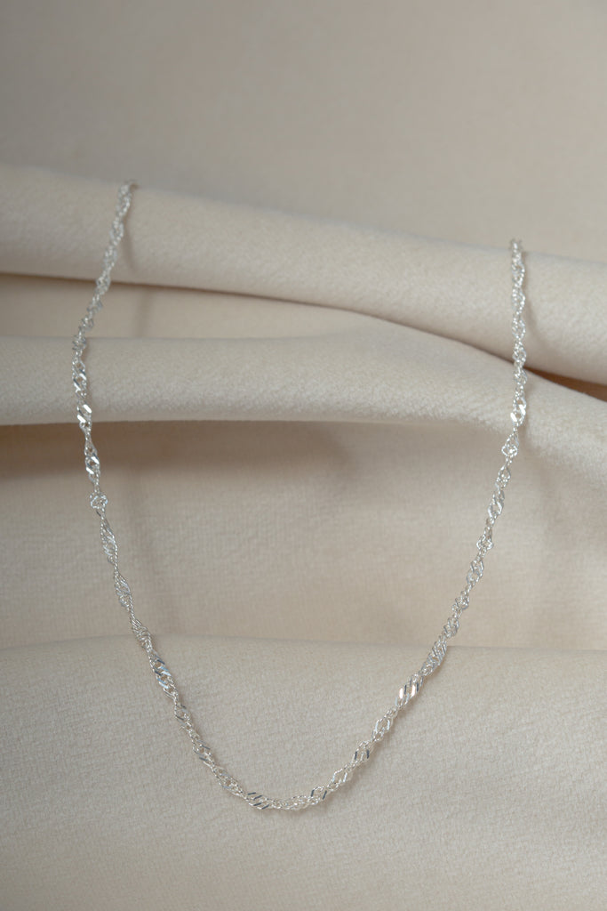 The Wanderer Silver Necklace on textile