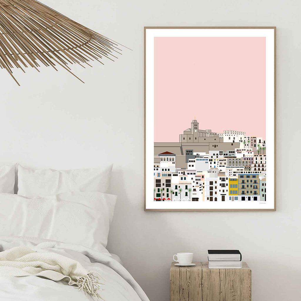 Graphic design giclée art print of Dalt Vila, Ibiza framed in white bedroom.