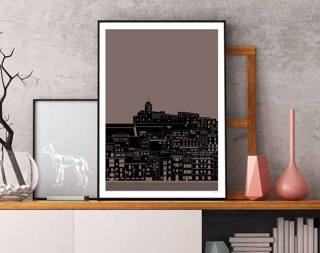 Framed graphic design giclée art print of Dalt Vila, Ibiza at night on display shelf