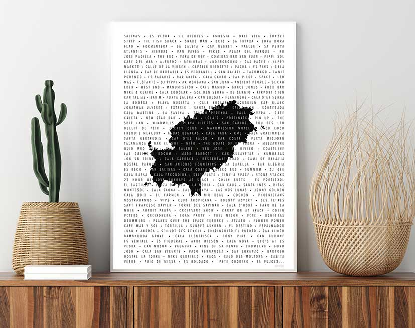 Framed print of list of special places in Ibiza over a watermark of the island from above