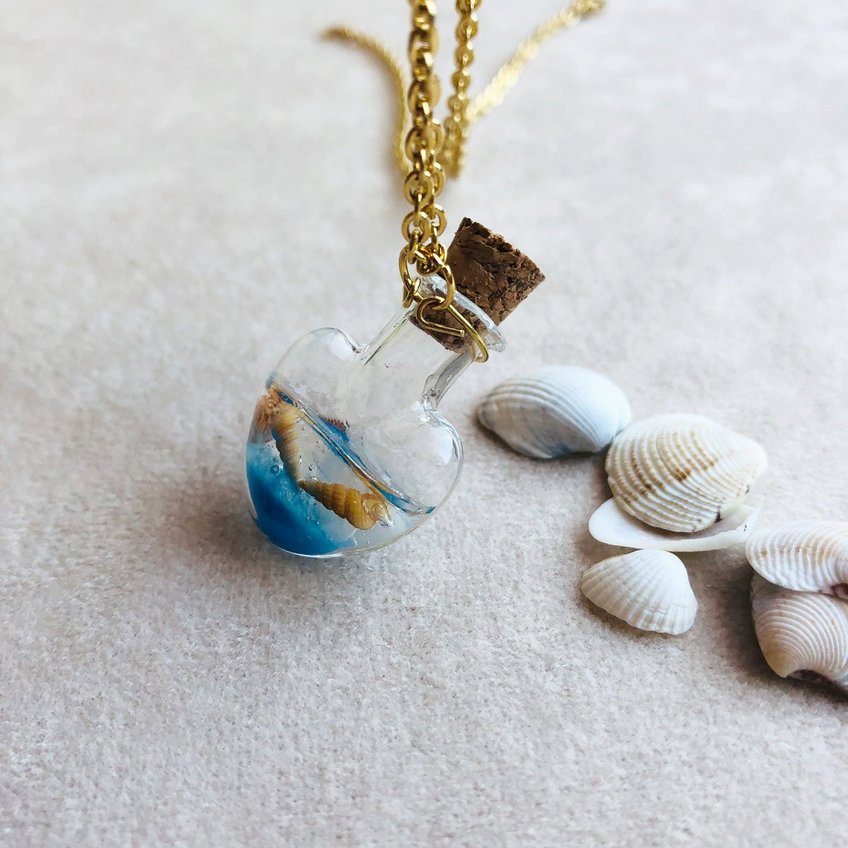 Summer | Sea shells in a heart glass bottle