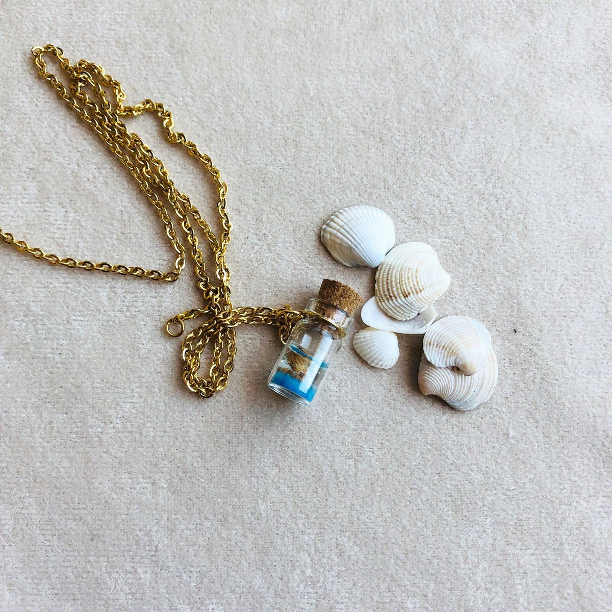 Summer | Sea shells in a tiny glass bottle