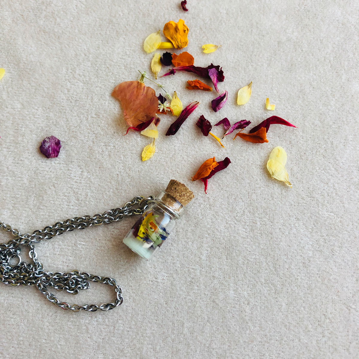 Tiny bottle with autumn leaves