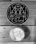 "1/2 oz Tusk sample and 3"" vinyl logo sticker"