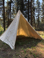 canvas tent in mountains