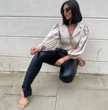 FAUX LEATHER TROUSERS WITH SPLITS