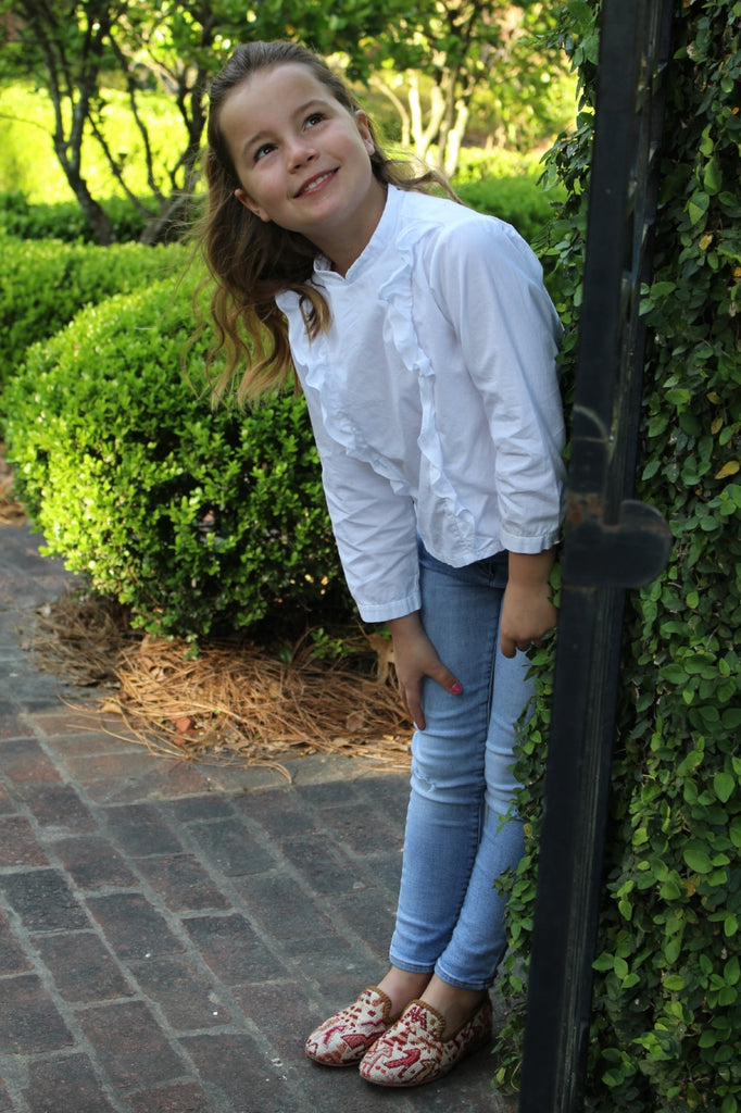 caroline outside in sumak kilim loafers, part of childrens shoes collection.