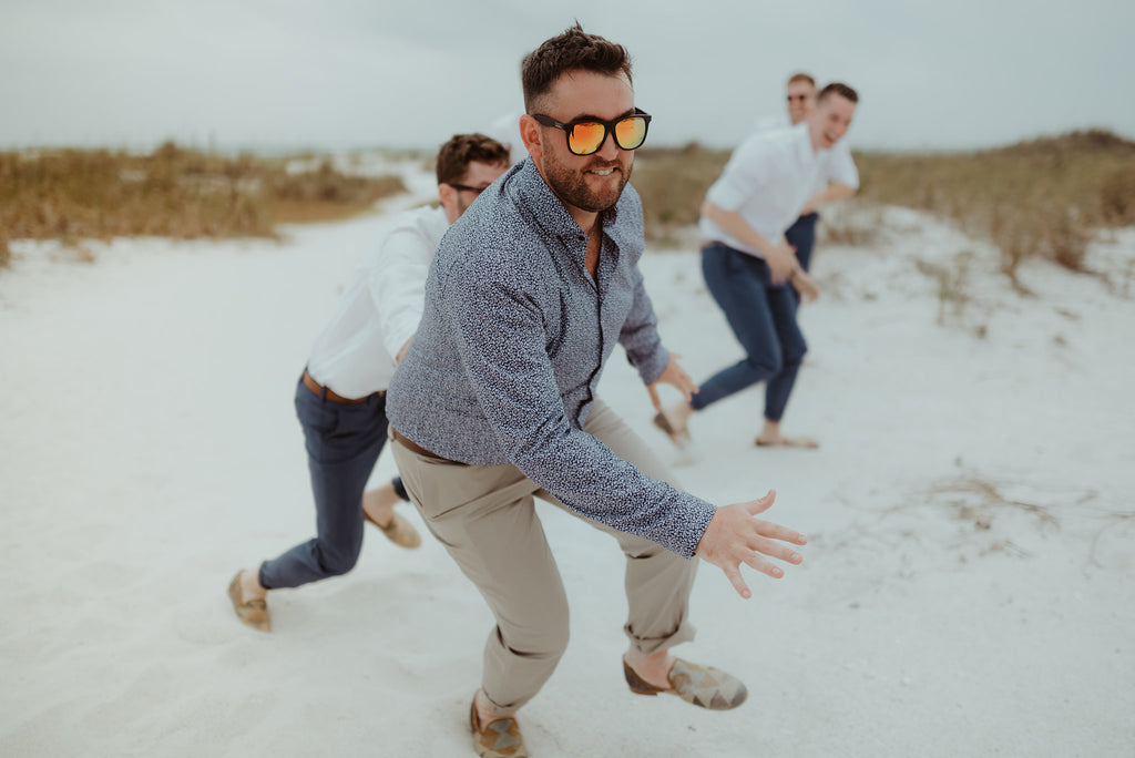 groom running on the beach in mens kilim loafers