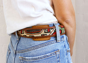 Artemis Kilim belt worn with Jeans and a white t.