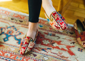 Women's Kilim Shoes in the Sumak print on Model Tory in the South End.