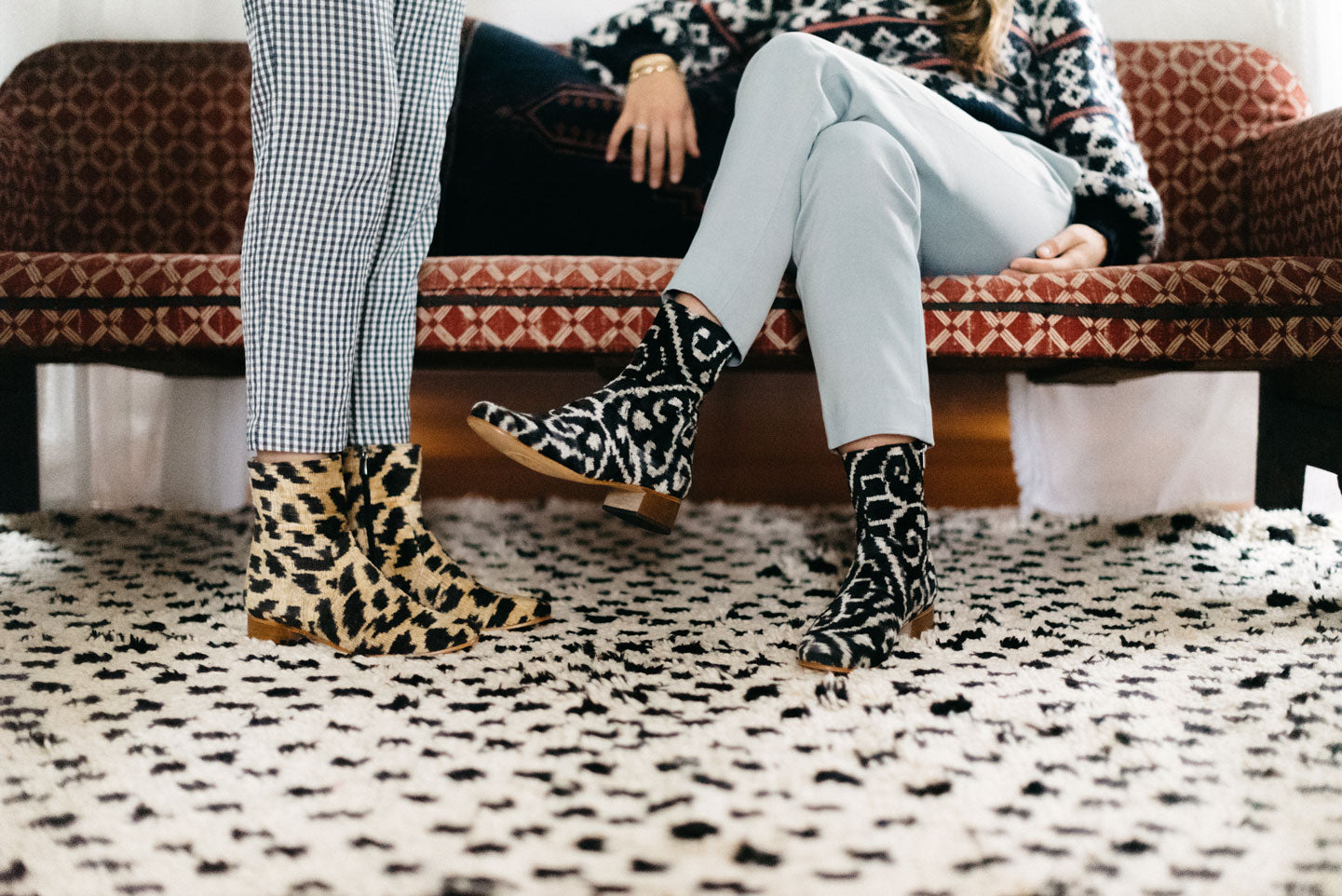 Our velvet boots styled on a moroccan carpet in the designer's home.