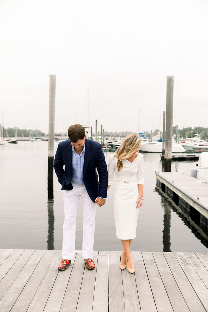 Trevor and Jackie Engagement shoot, Trevor is wearing our Men's Kilim Loafers. These photos were taken on a dock in Barrington, Rhode Island.