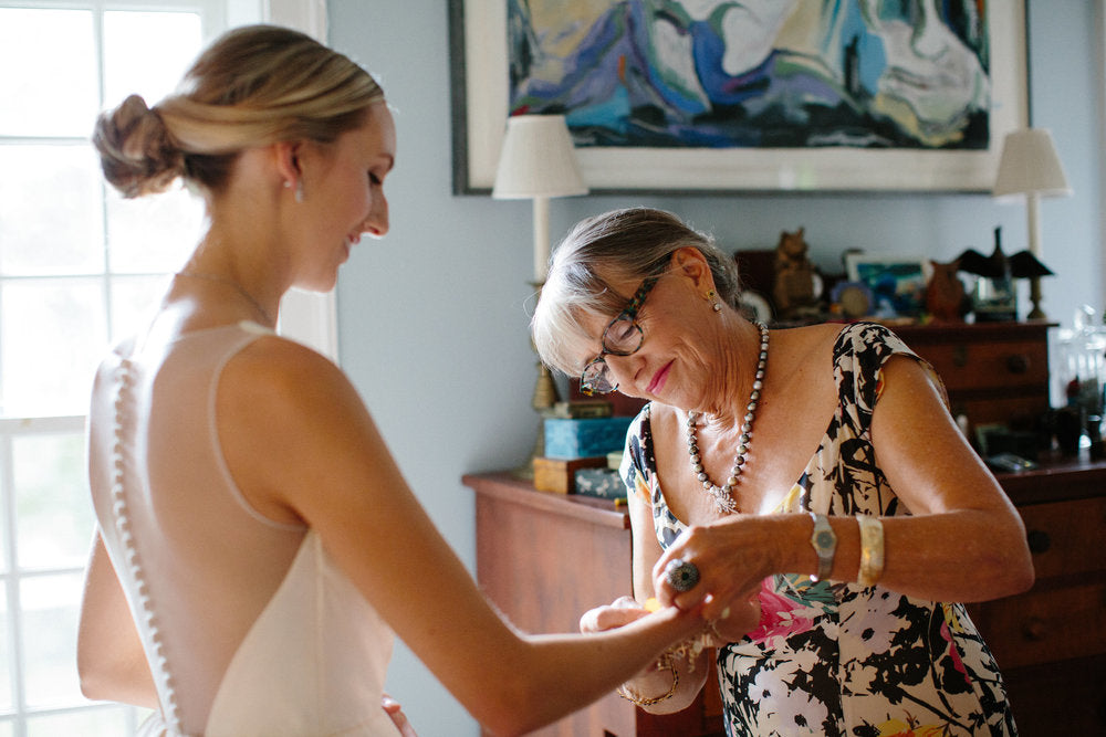 bride getting ready with her mom.