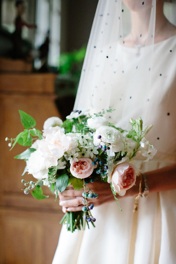 Photo of the brides bouquet. Bouquet is made up of roses and babies breath.